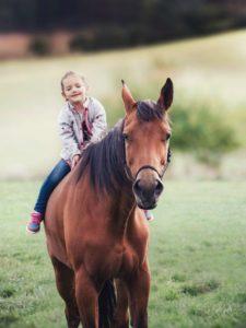 Girl Horseback riding