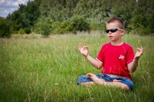 Boy with autism meditating to reduce stress